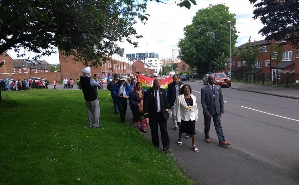 walk of friendship Eileen Taylor leads march