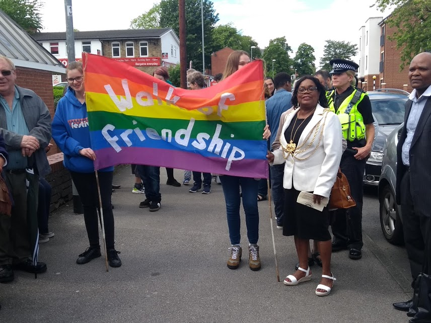 walk of friendship Eileen Taylor with banner